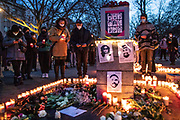 Participants hold candles during a memorial demonstration, commemorating the anniversary to the Hanau terror attack, in Berlin, Germany, February 19, 2021. About 800 participants took part in the event in remembrance of the Hanau shootings, in which ten people were killed and five others wounded. The shooting spree was committed on February 19, 2020 by a far-right extremist targeting two shisha bars and kiosks at the Hessian city of Hanau near Frankfurt. The gunman was identified as 43-year-old Tobias Rathjen. The majority of the victims were Germans with migrant backgrounds, among the victims was also the perpetrator's mother. (Photo by Omer Messinger)