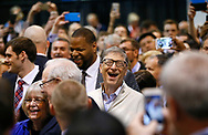 Microsoft co-founder and billionaire philanthropist Bill Gates reacts a a newspaper throwing contest before the Berkshire Hathaway annual meeting in Omaha, Nebraska, U.S. May 6, 2017 with Berkshire CEO Warren Buffett at left.  REUTERS/Rick Wilking