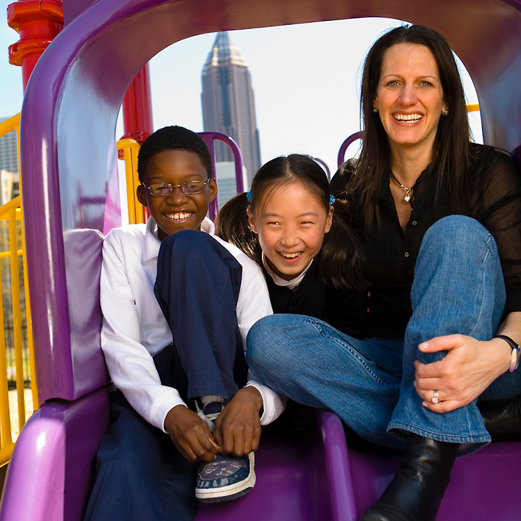 Randi Drake, HOA volunteer, with Eric and Alice Liu at an elementary school in downtown Atlanta.  Created for the 2006 spring Capital Fundraising Campaign.