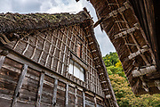 """In Ogimachi, the peaceful Gassho-zukuri Minka-en Outdoor Museum displays farmhouses relocated from surrounding villages. Ogimachi is the largest village and main attraction of the Shirakawa-go region, in Ono District, Gifu Prefecture, Japan. Declared a UNESCO World Heritage Site in 1995, Ogimachi village hosts several dozen well preserved gassho-zukuri farmhouses, some more than 250 years old. Gassho-zukuri means """"constructed like hands in prayer"""", as the farmhouses' steep thatched roofs resemble the hands of Buddhist monks pressed together in prayer. Their thick roofs, made without nails, are designed withstand harsh, snowy winters and to protect a large attic space that was formerly used to cultivate silkworms. Many of the farmhouses are now restaurants, museums or minshuku lodging."""