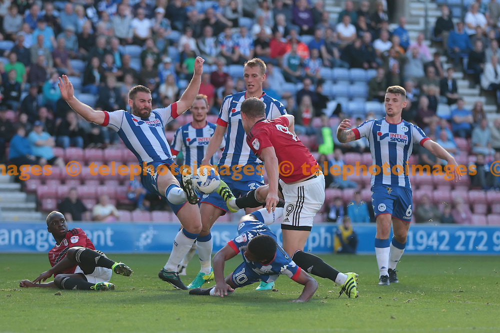 A goalmouth scramble during the Sky Bet Championship match between Wigan Athletic and Fulham at the DW Stadium in Wigan. September 17, 2016.<br /> Nigel Pitts-Drake / Telephoto Images<br /> +44 7967 642437