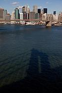 New York. The shadow of Manhattan bridge . general view on lower Manhattan,  Brooklyn bridge on east river , New York - United states  /  l ombre du pont de Manhattan. vue generale sur  le bas de la ville, le pont de Brooklyn et l'east river, Manhattan  New York - Etats-unis