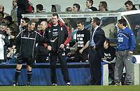 Photo. Glyn Thomas.<br /> Fulham v Blackburn. FA Barclaycard Premiership. <br /> Loftus Road, Luton. 12/04/2004.<br /> Fourth official Andy D'Urso (L) is forced to intervene to halt angry words between Fulham manager Chris Coleman (second from L) and Graeme Souness (second from R) after Fulham players did not kick the ball out from play to allow Jon Stead to receive treatment.