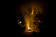 Migrants chatting next to a bonfire inside one of the abandoned warehouses. Belgrade, Serbia. January 14th 2016 Federico Scoppa