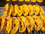 "12 FEBRUARY 2015 - BANGKOK, THAILAND:  A Thai snack called ""kanom buang,"" for sale in the new floating market on Khlong Phadung Krung Kasem, a 5.5 kilometre long canal dug as a moat around Bangkok in the 1850s. The floating market opened at the north end of the canal near Government House, which is the office of the Prime Minister. The floating market was the idea of Thai Prime Minister General Prayuth Chan-ocha. The market will be open until March 1.   PHOTO BY JACK KURTZ"
