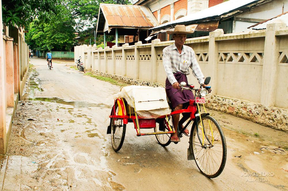 Man driving trishaw in Mandalay