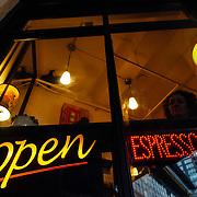 Heather Goodrich drinks espresso in an alley in downtown Seattle, Washington.
