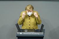 11 FEB 2021, BERLIN/GERMANY:<br /> Angela Merkel, CDU, Bundeskanzlerin, nimmt ihren Mundschutz ab, vor Beginn ihrer ihrer  Regierungserklaerung zur Bewaeltigung der Corvid-19-Pandemie, Plenum, Reichstagsgebaeude, Deutscher Bundestag<br /> IMAGE: 20210211-01-026<br /> KEYWORDS: Corona, Maske, Rede