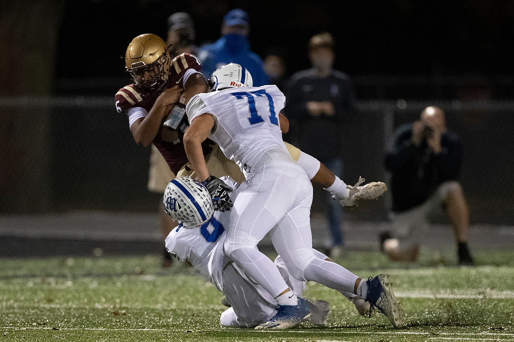 Marian defenders make the tackle on Jimtown's Tysen House during the Marian-Jimtown high school football game on Friday, November 06, 2020, at Knepp Field in Elkhart, Indiana.