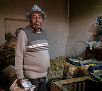 MARAS, PERU - CIRCA SEPTEMBER 2019:  Portrait of Peruvian man inside his home on the village of Maras, near Cusco in region known as Sacred Valley