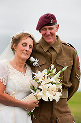 Happy Couple reenactors Andy and Kath after their 1940's wedding in Lytham Andy in his 6th Airborne Battle dress and Kath wearing a reproduction 1940s wedding dress..19 August 2011  Image © Paul David Drabble
