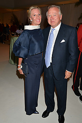 LORD & LADY BAMFORD at a dinner hosted by Cartier in celebration of The Chelsea Flower Show held at The Hurlingham Club, London on 19th May 2014.