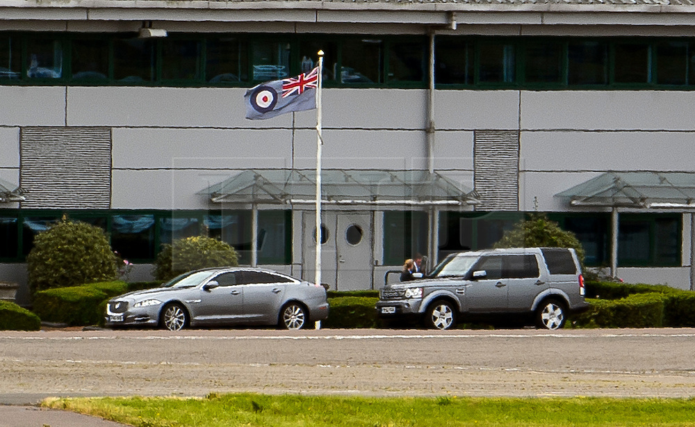 © Licensed to London News Pictures. 15/07/2016. London, UK.  Prime Minister Theresa May's convoys is seen on the tarmac at RAF Northolt. Mrs May is going to Scotland to meet with First Minister Nicola Sturgeon in Edinburgh on her first visit as Prime Minister. Photo credit: Ben Cawthra/LNP