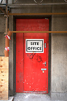 Red construction site office door on a building in the city centre in Dublin Ireland