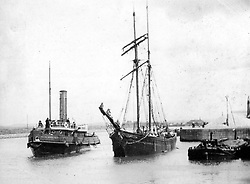 """© Licensed to London News Pictures. 04/05/2016. Birkenhead UK. Collect picture shows the Ralph Brocklebank (Daniel Adamson) in Ellesmere Port in the early 1900's. The Daniel Adamson steam boat has been bought back to operational service after a £5M restoration. The coal fired steam tug is the last surviving steam powered tug built on the Mersey and is believed to be the oldest operational Mersey built ship in the world. The """"Danny"""" (originally named the Ralph Brocklebank) was built at Camel Laird ship yard in Birkenhead & launched in 1903. She worked the canal's & carried passengers across the Mersey & during WW1 had a stint working for the Royal Navy in Liverpool. The """"Danny"""" was refitted in the 30's in an art deco style. Withdrawn from service in 1984 by 2014 she was due for scrapping until Mersey tug skipper Dan Cross bought her for £1 and the campaign to save her was underway. Photo credit: Andrew McCaren/LNP ** More information available here http://tinyurl.com/jsucxaq **"""