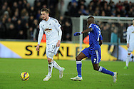 Gylfi Sigurdsson of Swansea city breaks away from Ramires of Chelsea. Barclays Premier League match, Swansea city v Chelsea at the Liberty Stadium in Swansea, South Wales on Saturday 17th Jan 2015.<br /> pic by Andrew Orchard, Andrew Orchard sports photography.