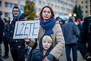 """A mother protesting with her child in front of  """"Top Hotel"""" in Prague's quater Chodov. The sign reads """"You are lying"""". They are protesting for European values and against the conference of the European anti-migrant parties """"Europe of Nations and Freedom"""" (ENF). Attending were Marie Le Pen from France, Geert Wilders from Holland and Tomio Okamura of the Freedom and Direct Democracy (SPD) movement from Czech Republic which was hosting the meeting."""