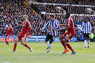 Sheffield Wednesday striker Gary Hooper (14) scores the opening goal 1-0 during the Sky Bet Championship match between Sheffield Wednesday and Cardiff City at Hillsborough, Sheffield, England on 30 April 2016. Photo by Phil Duncan.