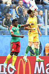2017?6?23?.   ????????——?????????????????.    6?22????????????????????????????????.    ??????????????2017????????B???????????1?1?????????.    ?????????..(SP)RUSSIA-ST. PETERSBURG-2017 FIFA CONFEDERATIONS CUP-CMR VS AUS..(170623) -- ST. PETERSBURG, June 23, 2017  Collins Fai (L) of Cameroon competes for a header with Mathew Leckie of Australia during the group B match between Cameroon and Australia of the 2017 FIFA Confederations Cup in St. Petersburg, Russia, on June 22, 2017. The match ended with a 1-1 tie.  7 9854294892 (Credit Image: © Xu Zijian/Xinhua via ZUMA Wire)
