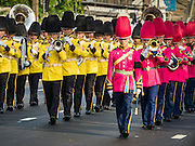 16 DECEMBER 2015 - BANGKOK, THAILAND: A Thai military band in the funeral procession for Somdet Phra Nyanasamvara, who headed Thailand's order of Buddhist monks for more than two decades and was known as the Supreme Patriarch. He died in 2013. He was ordained as a Buddhist monk in 1933 and appointed as the Supreme Patriarch in 1989. He was the spiritual advisor to Bhumibol Adulyadej, the King of Thailand when the King served as a monk in 1956. Tens of thousands of people lined the streets during the procession to pray for the Patriarch.     PHOTO BY JACK KURTZ