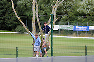 Football fans climb a tree for a view as the Wales football team train at the FAW base, Dragon Park in Newport, South Wales on Monday 12th August 2013. pic by Andrew Orchard,  Andrew Orchard sports photography,