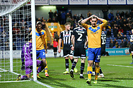Mansfield Town forward Danny Rose (32) holds his head after a header goes over the cross bar during the EFL Sky Bet League 2 match between Mansfield Town and Grimsby Town FC at the One Call Stadium, Mansfield, England on 4 January 2020.