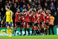 AFC Bournemouth forward Callum Wilson celebrates scoring a goal from the penalty spot with his team mates to give a 2-0 lead to the home team during the Premier League match between Bournemouth and Arsenal at the Vitality Stadium, Bournemouth, England on 3 January 2017. Photo by Graham Hunt.
