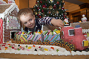 27/11/2014 Repro freeThe wonder of Christmas! Shane  Lia Corcoran Clarinbridge took a peek at Hotel Meyrick's stunning creation of a traditional Gingerbread train station and set which is on display in the parlour lounge until Christmas Eve when it will be donated to the St Bernadette's children's ward at University College hospital Galway, www.hotelmeyrick.ie. <br />  . Photo:Andrew Downes