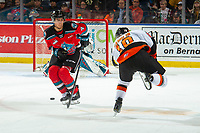KELOWNA, BC - NOVEMBER 8:  Devin Steffler #4 of the Kelowna Rockets tries to block a shot by James Hamblin #10 of the Medicine Hat Tigers at Prospera Place on November 8, 2019 in Kelowna, Canada. (Photo by Marissa Baecker/Shoot the Breeze)
