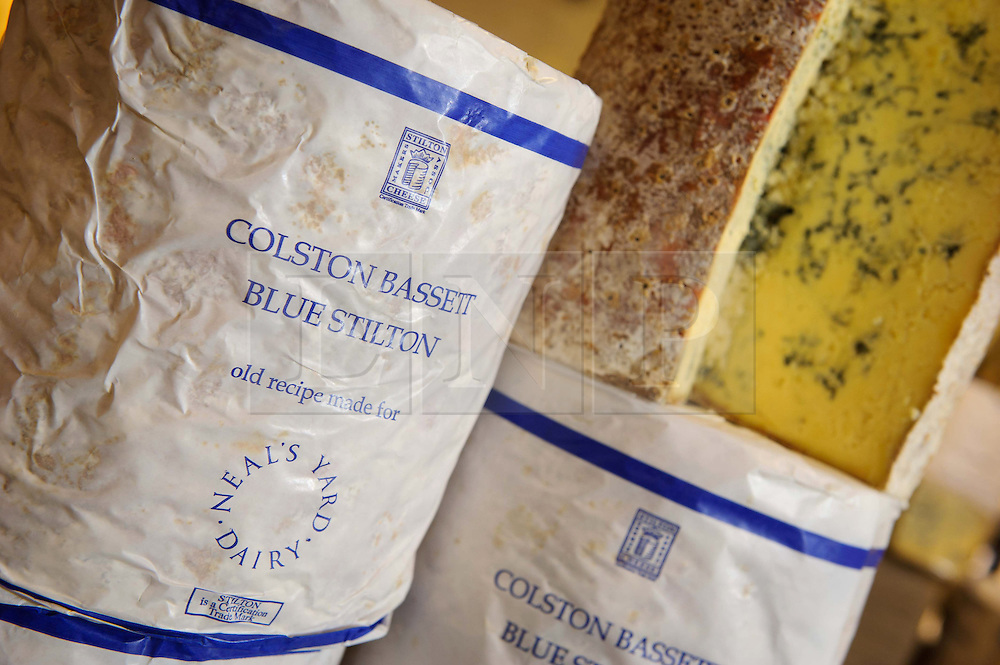 "© Licensed to London News Pictures. 17/12/2013 London, UK. The 100th anniversary of Colston Bassett Stilton at Whole Foods Market, Kensington, London. The world renowned cheese has been made in the same Nottinghamshire factory  since 1913 where only 4 head cheese makers have overseen the process. The cheese won  ""Best British Cheese' at this years World Cheese Awards.<br /> Photo credit : Simon Jacobs/LNP"