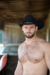 shirtless rugged cowboy outdoors