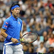 2016 U.S. Open - Day 10  Kei Nishikori of Japan in action against Andy Murray of Great Britain in the Men's Singles Quarterfinal match on Arthur Ashe Stadium on day ten of the 2016 US Open Tennis Tournament at the USTA Billie Jean King National Tennis Center on September 7, 2016 in Flushing, Queens, New York City.  (Photo by Tim Clayton/Corbis via Getty Images)