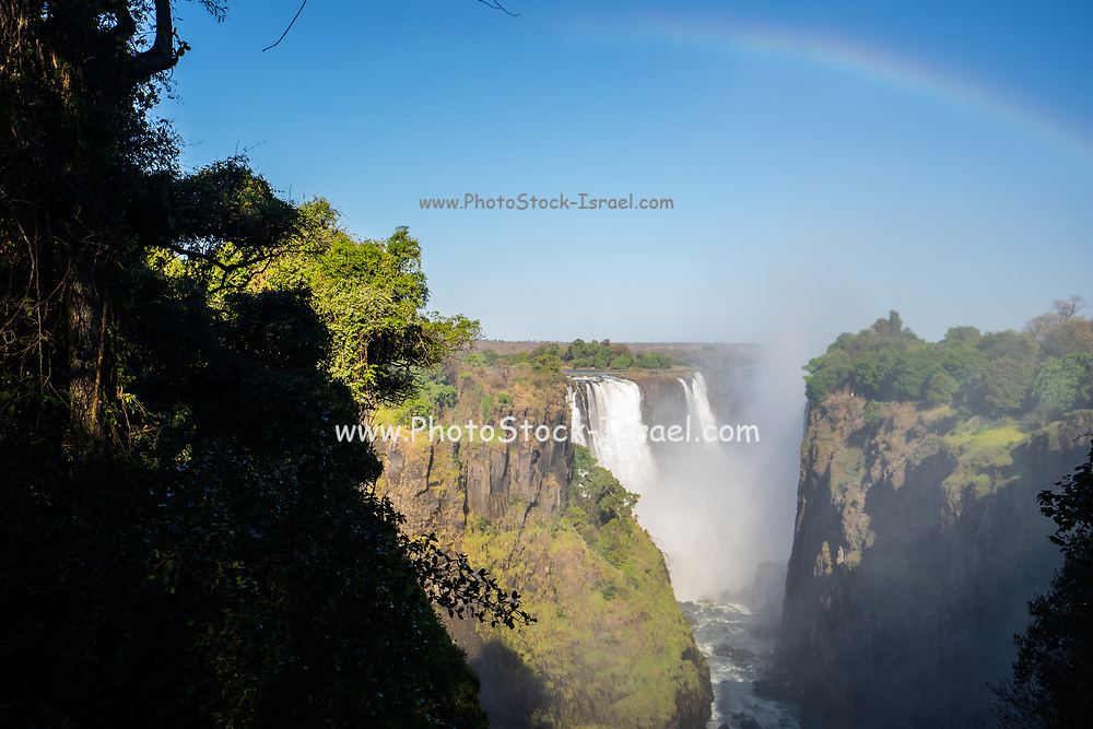 Rainbow in the spray of Victoria Falls on the Zambia and Zimbabwe border, Africa.