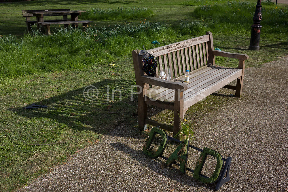 A park bench dedicated to a dead relative in the south London public space called Ruskin Park in the south London borough of Southwark. Memorial benches paid for by grieving relatives are a popular way of remembering deceased loved-ones in a place liked during their lifetime. Inscriptions along the back often give the persons name and dates of birth and death along with a short statement about how they loved this place.