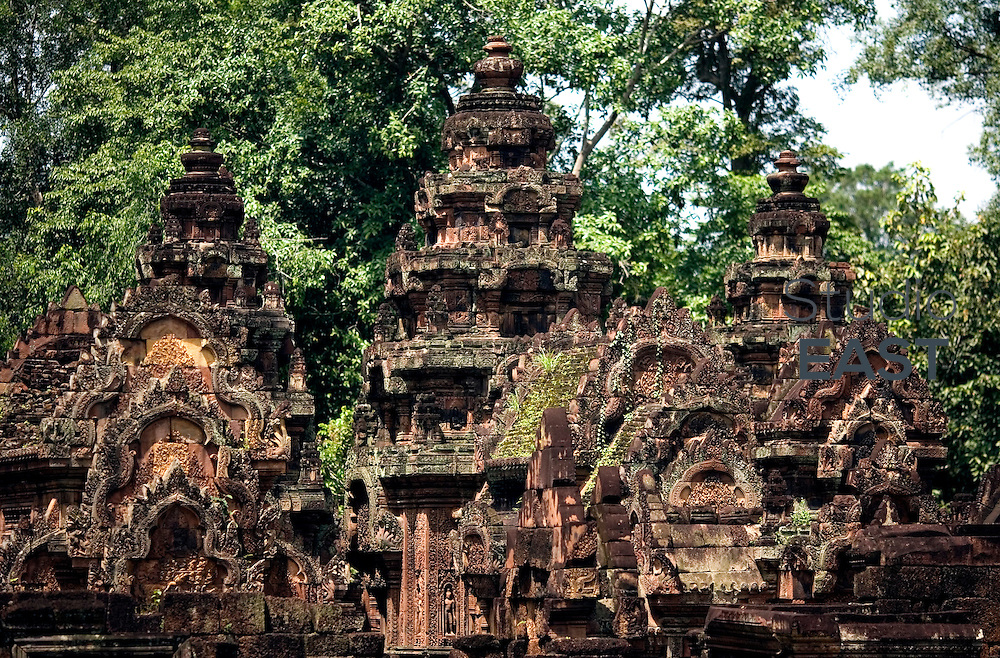 The rooves of Banteay Srei temple, in Ankgor, Cambodia, on October 5, 2009. Banteay Srei (or Banteay Srey, meaning Citadel of women)  is a 10th century Cambodian temple, built largely of red sandstone, and dedicated to the Hindu god Shiva. Angkor used to be the seat of the Khmer empire, which flourished from approximately the ninth century to the thirteenth century. The ruins of Angkor temples are a UNESCO World Heritage Site. Photo by Lucas Schifres/Pictobank