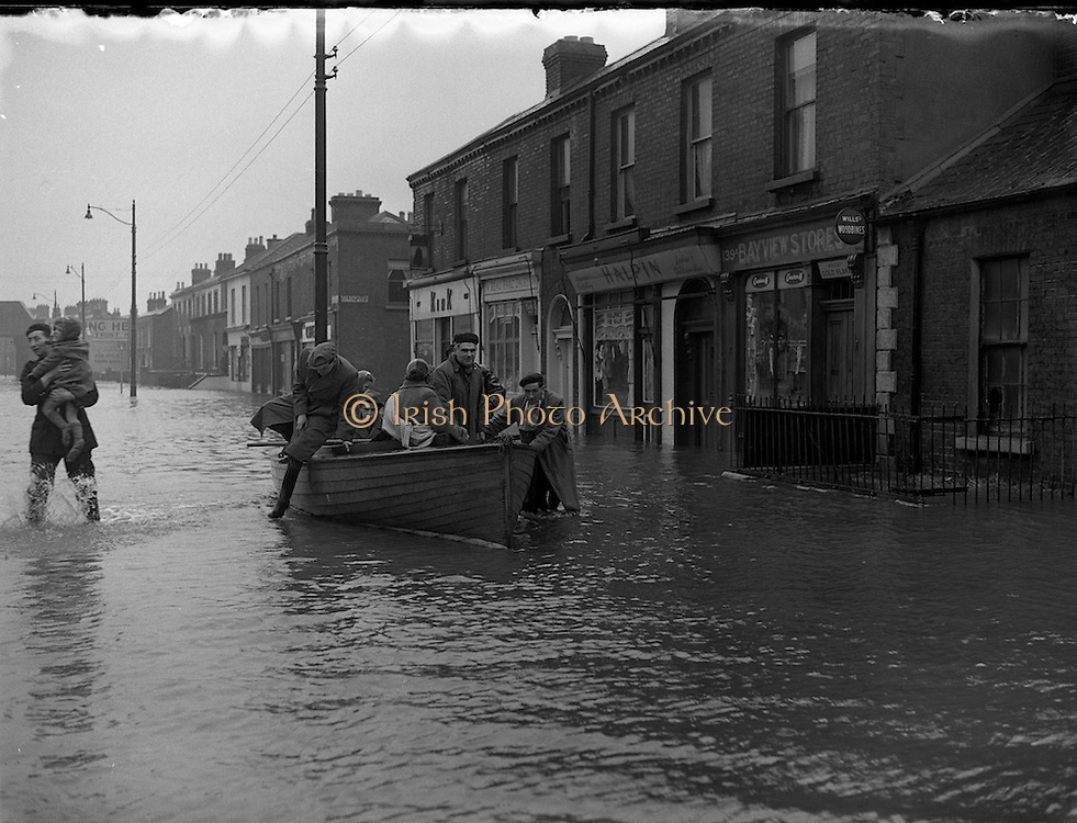 People rescued in a boat during the flooding along North Strand Street between the 8th-12th of December 1954.