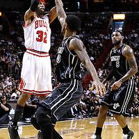 29 January 2012: Chicago Bulls shooting guard Richard Hamilton (32) takes a jumpshot over Miami Heat power forward Udonis Haslem (40) during the Miami Heat 97-93 victory over the Chicago Bulls at the AmericanAirlines Arena, Miami, Florida, USA.