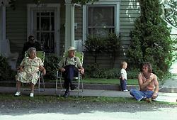 Americana Small town spectators gather for holiday celebration parade. Stock photo
