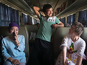 Students. Life inside the train - mostly Muslim Uighur people  ride this train.