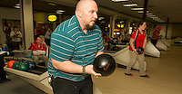 """Mr. Scoffield and Samantha Batchelder get serious as they step onto the bowling lanes at Funspot Thursday afternoon for """"bragging rights"""" during the LHS Bowling Challenge pitting the LHS Bowling team against LHS faculty.  (Karen Bobotas/for the Laconia Daily Sun)"""