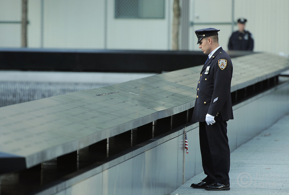 A New York City police officer looks out at the South Pool of the 9/11 Memorial during tenth anniversary ceremonies at the site of the World Trade Center September 11, 2011, in New York. POOL/Justin Lane/EPA