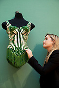 London, UK. Friday 23rd November 2012. Christies auction house showcasing memorabilia from every decade of the past century of popular culture from the industries of film and music. A couture corset in green silk with conical cups and beaded fringe, by Jean Paul Gaultier, Paris, worn by Madonna during the Blond Ambition tour, 1990.