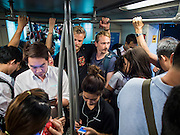 15 OCTOBER 2014 - BANGKOK, THAILAND:  Tourists ride the Sukhumvit Line of the BTS, the Bangkok Skytrain. The number of tourists arriving in Thailand in July fell 10.9 per cent from a year earlier, according to data from the Department of Tourism. The drop in arrivals is being blamed on continued uncertainty about Thailand's political situation. The tourist sector accounts for about 10 per cent of the Thai economy and suffered its biggest drop in visitors in June - the first full month after the army took power on May 22. Arrivals for the year to date are down 10.7% over the same period last year.   PHOTO BY JACK KURTZ