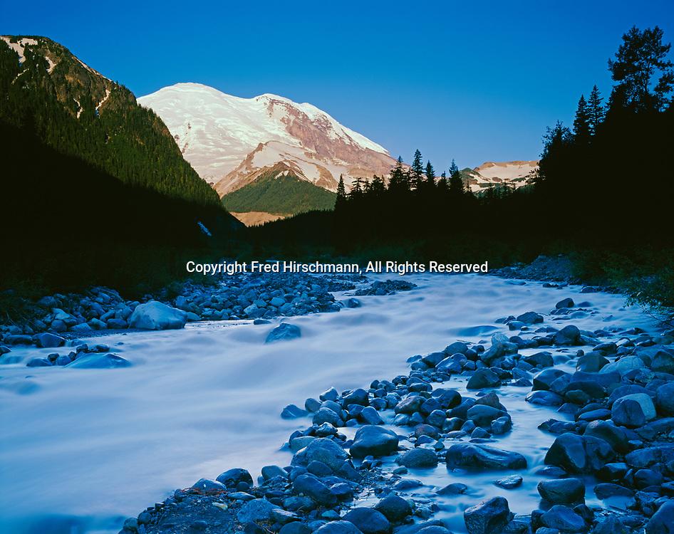 Volcanic summit of Mount Rainier looming beyond the White River, Mount Rainier National Park, Washington.