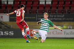 Leyton Orient's Lloyd James chips the ball over Yeovil Town's Byron Webster's challenge - Photo mandatory by-line: Dougie Allward/JMP - Tel: Mobile: 07966 386802 09/01/2013 - SPORT - FOOTBALL - Matchroom Stadium - London -  Leyton Orient v Yeovil Town - Johnstone's Paint Trophy Southern area semi-final.