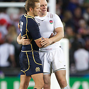 Dan Parks, Scotland, is consoled by Mike Tindall, England after the England V Scotland Pool B match during the IRB Rugby World Cup tournament. Eden Park, Auckland, New Zealand, 1st October 2011. Photo Tim Clayton...