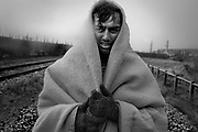 Afghan boys, fleeing from war and poverty in their homeland, sleep under old train wagons and in tents in the outskirts of the French port city of Calais. Facing nightly police harrasment and being fully dependent on charity organisations, they are waiting to gain passage to Britain either by help of a human smuggler or by clinging unto the underside of a lorry.