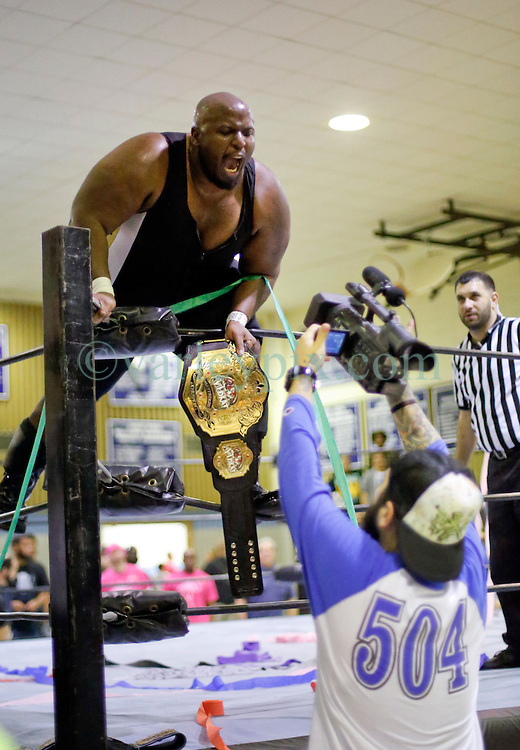 12 March 2016. Metairie, Louisiana.<br /> Wrestling action from Wildkat Sports and Entertainment's 'March into Mayhem' at the Meisler Middle School. 'Notorious' Shane Taylor defeats Stevie Richards and 'One Man' Mike Dell via pinfall to defend the Wildkat Heavyweight Championship<br /> Photo©; Charlie Varley/varleypix.com