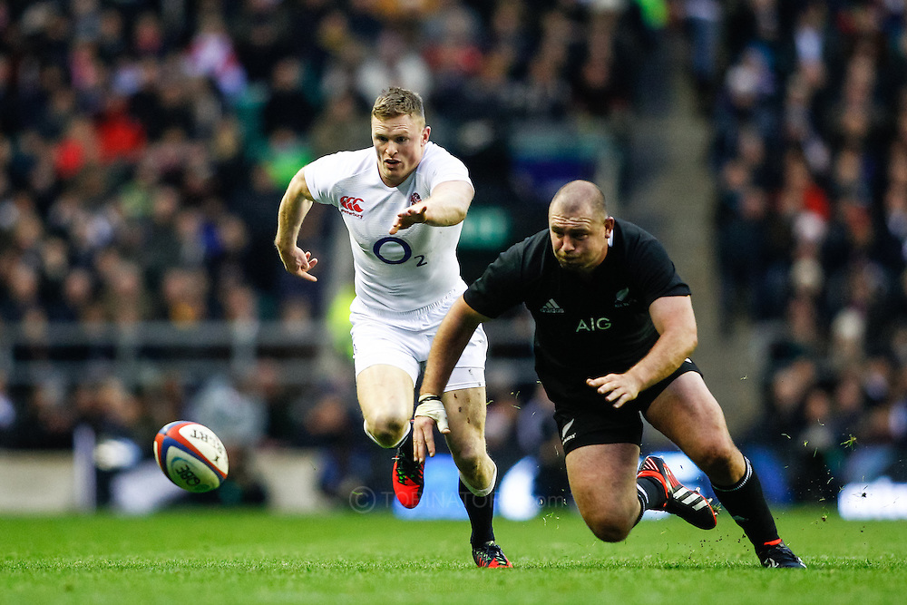 Picture by Andrew Tobin/SLIK images +44 7710 761829. 2nd December 2012. Chris Ashton of England (L) and Tony Woodcock of New Zealand (R) go for a loose ball during the QBE Internationals match between England and the New Zealand All Blacks at Twickenham Stadium, London, England. England won the game 38-21.