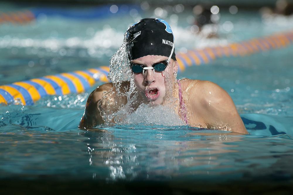 Katie Braun swims laps during a club practice at Oak Point Middle School in Eden Prairie, Minnesota on Sept. 30, 2003.(Photo By: Adam M. Bettcher)